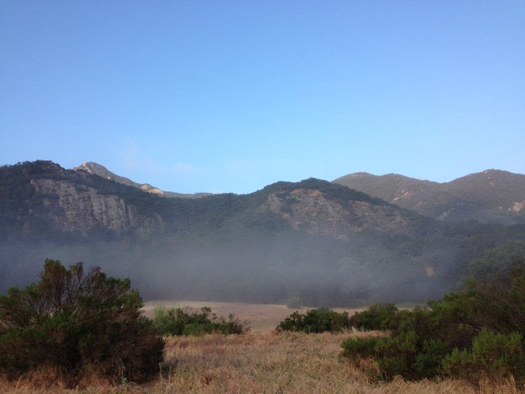 Fog still hanging at the base of the mountain